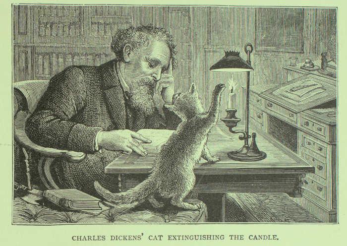Charles Dickens escribiendo con su gato